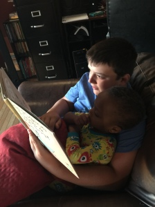 Eddy reading to Jimmy.
