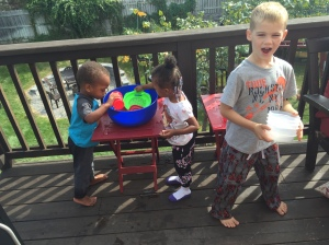Jimmy, Love, & SJ playing with water on the deck